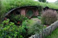 Image shows a hobbit hole from the filming of The Lord of the Rings.