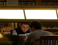 two students at library desk